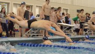 Senior Max Keeter anchors the 400 yard Freestyle Relay. Photo by Annie Lomshek.