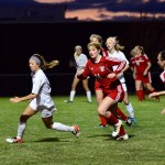 Junior Josie Clough sprints to the ball. Photo by Diana Percy