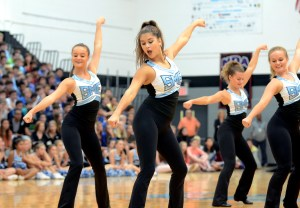 Senior Hayley Bell performs alongside her varsity Lancer Dancer teammates Catherine Watkins, Sam Shrout, and Isa Tamburini in a jazz dance. Photo by Maddie Smiley