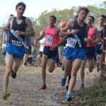 Sophomore Griffith and senior Jack Young run next to each other in the beginning of the race. Photo by Carson Holtgraves
