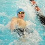 Freshman Oliver Massa swims the 100 backstroke. Photo by Luke Hoffman