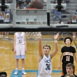 With the players on the court ready to get the rebound, sophomore Andy Maddox shoots a free throw. Photo by Grace Goldman