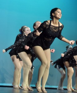 Senior Hayley Bell shakes her shoulders and smiles during her first performance. Photo by Katherine McGinness