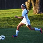 Junior Claire Long looks to clear the ball away from her goal. Photo by Laini Reynolds