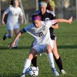 Senior Josie Clough holds back her opponent in order to keep her away from the ball. Photo by Ellen Swanson