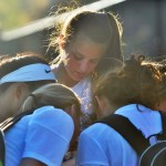 Freshman Eleanor Hlobik and teammates share their new team and individual pictures. Photo by Libby Wilson