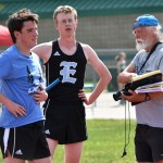 Sophomore Alex Washburn and junior Andrew Moore talk to Coach Chaffee after their relay. Photo by Laini Reynolds
