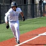 Freshman Robert Moore runs to home plate scoring the first run. Photo by Izzy Zanone