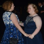 Senior Annie Renner and junior Hannah McConville dance with each other at prom to the band's music. Photo by Morgan Plunkett