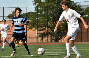 Dribbling down the sideline, junior Charley Colby dribbles past sophomore Byers Waldo. Photo by Lucy Morantz
