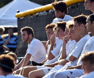 Juniors Will Tulp and Charley Colby along with seniors Tommy Nelson, Alex True, Bennet Meeds, Sam Thompson, and Sam Ragland focus in on Coach Kelly during the halftime lecture. Photo by Lucy Morantz