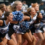The varsity cheerleaders join in a chant with the student section. Photo by Kate Nixon
