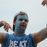 Senior Brian Christian gets the students excited at the pep rally before the game starts. Photo by Reilly Moreland