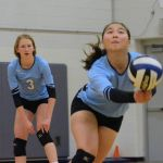 Sophomore Shelby Winter hits the ball while Freshman Mia Roman stands by for defense. Photo by Hadley Hyatt