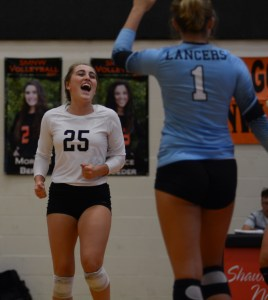 After they score a point, Senior Ally Huffman and teammate Senior Sydney Ashner cheer. Photo by Aislinn Menke