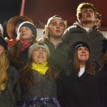 The SME student section sings the school song after the Lancer's loss. Photo by Luke Hoffman