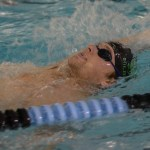 Senior Brian Christian swims a 25 backstroke. Photo by Kathleen Deedy