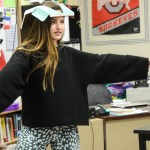 Sophomore Carolyn Popper balances the top of a tissue box on her head. Photo by Kathleen Deedy