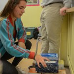 Sophomore Willa Ivancic helps out her hour and takes charge of the building process. Photo by Kathleen Deedy