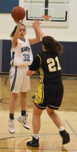 Sophomore Sydney Daris shoots a basket, scoring another point for the Lancers. Photo by Ellen Swanson