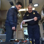 Senior Ben Scott looks over his ECG reading (heart rhythm) with paramedic Tony Burr. Photo by Ava Simonsen