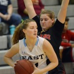 Junior Emma Eberhart prepares to pass the ball. Photo by Ally Griffith