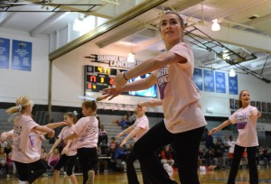 Senior Isabelle Cunningham does a double turn while performing with girls from the Lancer Dancer clinic. Photo by Aislinn Menke