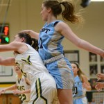 Attempting to grab the rebound from a South player, junior Emma Eberhart jumps up to try and reach the ball. Photo by Aislinn Menke