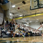 Senior Kelyn Bolton takes the jumpshot with the South defender in his face. Photo by Ty Browning