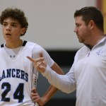 Coach Gagnon gives freshman Preston Reynolds some tips before he is subbed back into the game. Photo by Aislinn Menke