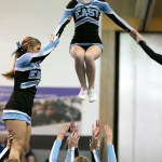 Freshman flyer Helen Sniezek jumps out of her base groups hands. Photo by Lucy Morantz