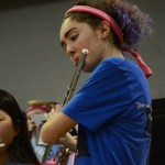 Sophomore Josephine Cotton plays her flute during a band song. Photo by Kathleen Deedy