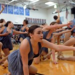 """Senior Isabelle Cunningham dances in the Lancer Dancer performance. Cunningham says, """"This is our home routine. We do that at camp and we get judged and that's how we get our bid to Nationals. It was choreographed by Bubba and the goal was to say goodbye to the seniors.""""  Photo by Izzy Zanone"""
