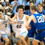 Junior Jack Gilman sprints down the court to the ball. Photo by Luke Hoffman