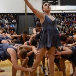 Senior Isabelle Cunningham poses with one arm raised during the varsity lancer dancer performance. Photo by Grace Goldman