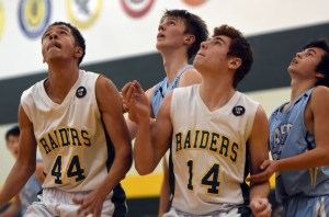 Sophomores Ben Schneider and Brock Smith and their opponents look at the goal as they wait for the basketball to drop. Photo by Katherine Odell