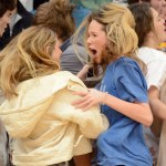 """Sophomores Charlotte Brock and Anna Peters do the """"Do It"""" chant with their classmates. Photo by Katherine McGinness"""