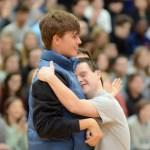 Junior Jack Melvin hugs sophomore Jack Waters. Photo by Katherine McGinness