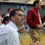 Near the end of the second quarter assistant coach Ryan Oettmeier watches the game closely. Photo by Lucy Morantz