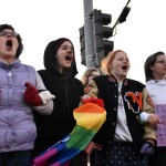 """A woman instructs the teenagers to link arms facing the protesters and chant """"love is love!"""". Photo by Lucy Morantz"""