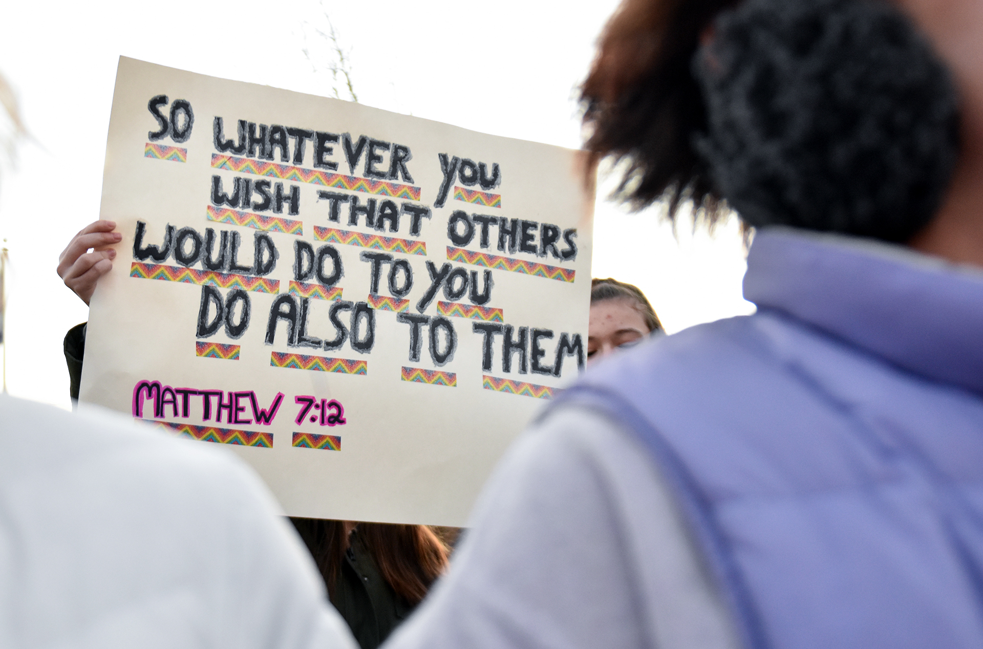 A student holds a home made sign above the crowd of anti-protesters. Photo by Lucy Morantz