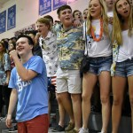 At the conclusion of the game, junior Jack Melvin leads the student section in the school song. Photo by Lucy Morantz