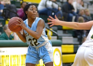 Sophomore Yasmeen Byers keeps the ball away from her opponent. Photo by Luke Hoffman