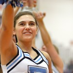 In the final minutes of the game, junior Lucy Crum and the Lancer Dancers cheer up the crowd. Photo by Luke Hoffman