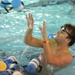 Senior Brian Christian is tossed a pool buoy used for practicing stroke only. Photo by Luke Hoffman