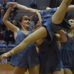 Juniors Gia Hense, Scout Rice and Maggie Mulligan lift up Sam Shrout in the Lancer Dancer's half time show routine. Photo by Morgan Plunkett