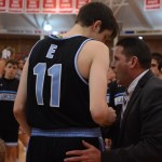 Senior Jack Schoemann and coach Shawn Hair talk together before the game. Photo by Reilly Moreland
