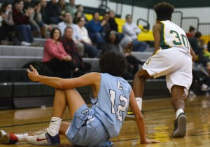 Sophomore Brock Smith looks for a foul after he fell trying to get a steal. Photo by Ty Browning