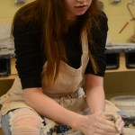 Sophomore Jessica Hickey carefully centers her clay on the pottery wheel. Photo by Kathleen Deedy