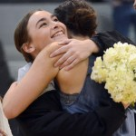 Senior Isabelle Cunningham hugs junior Maggie Mulligan as the senior lancer dancers are being announced. Photo by Katherine McGinness
